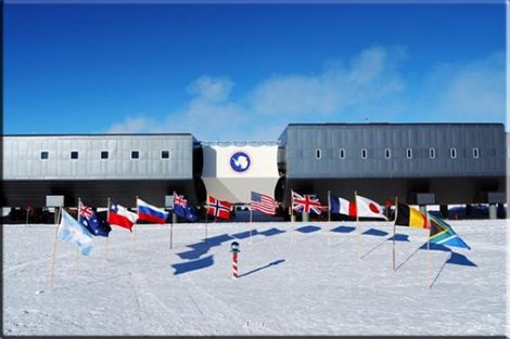 Flags fly at the ceremonial South Pole in front of the Elevated Station in honor of the 12 original signatory nations of the Antarctic Treaty. The flags are set in a semicircle and are spaced about 1.5 meters (5 feet) apart. The US flag is directly flanked by the Norwegian (grid east) and British (grid west) flags in honor of Amundsen and Scott. The remainder of the flags are represented in the order of their signing the Antarctic Treaty. The nations represented include: Argentina, Australia, Chile, Russia, New Zealand, Norway, USA, UK, France, Japan, Belgium, and South Africa. (February 2008)